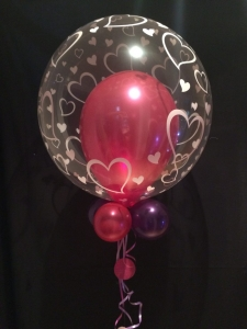 Heart bubble with pearlised balloon inside and small balloon collar