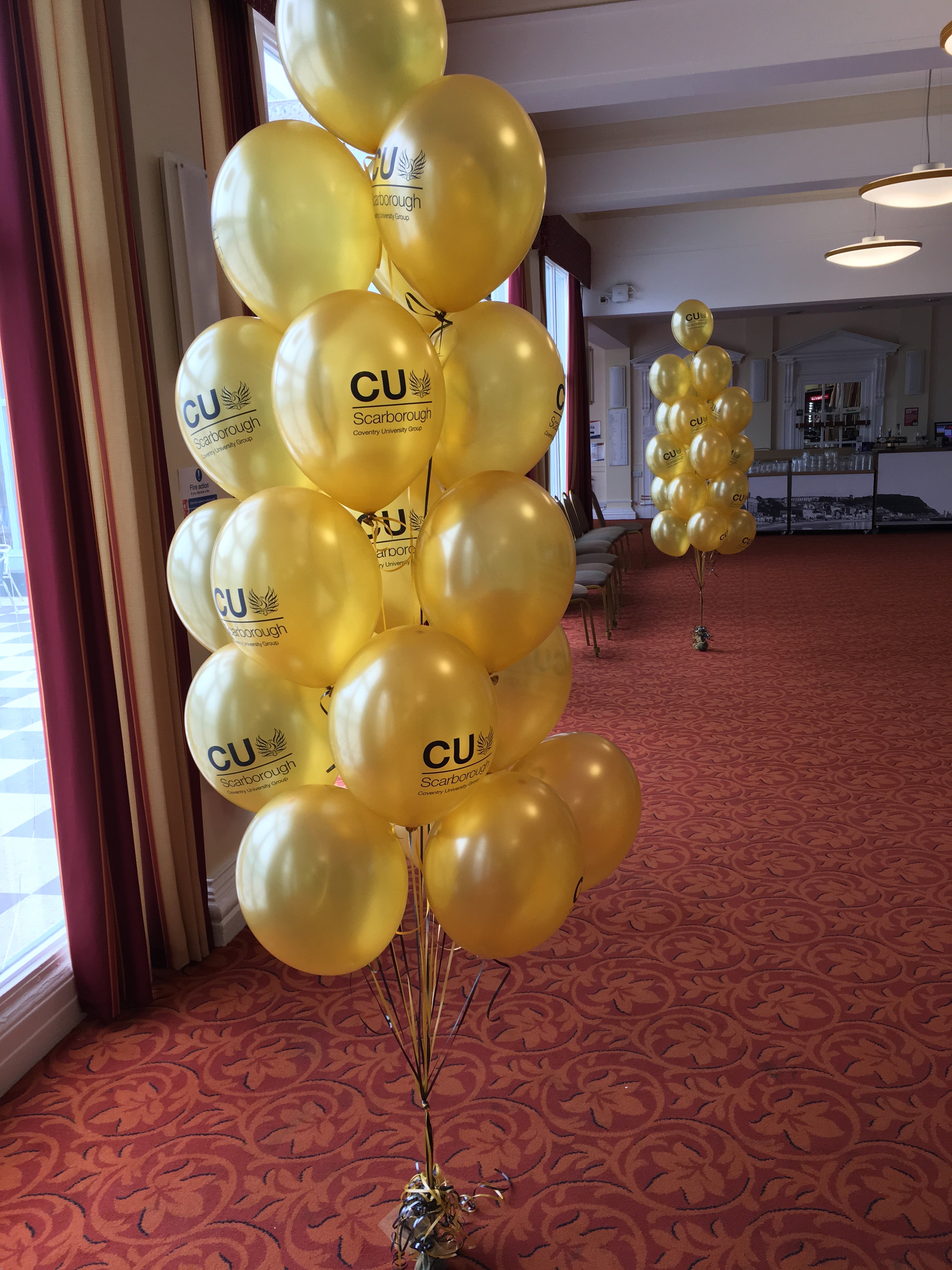 Coventry University branded balloons display cluster