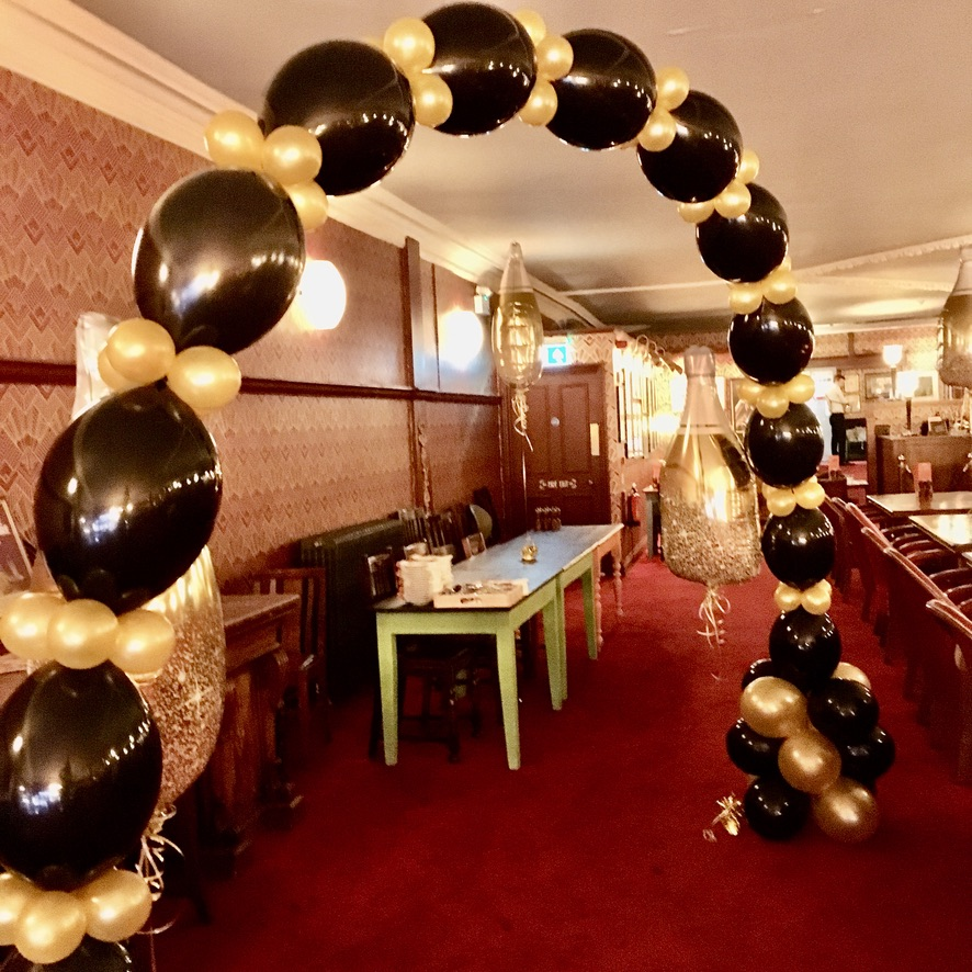Helium balloon linked arch