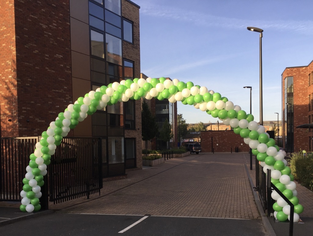 Giant spiral balloon arch over car park entrance