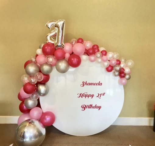 Circle board with organic balloon display for special birthdays