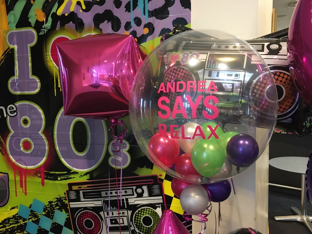 1980's themed balloons and wall decor