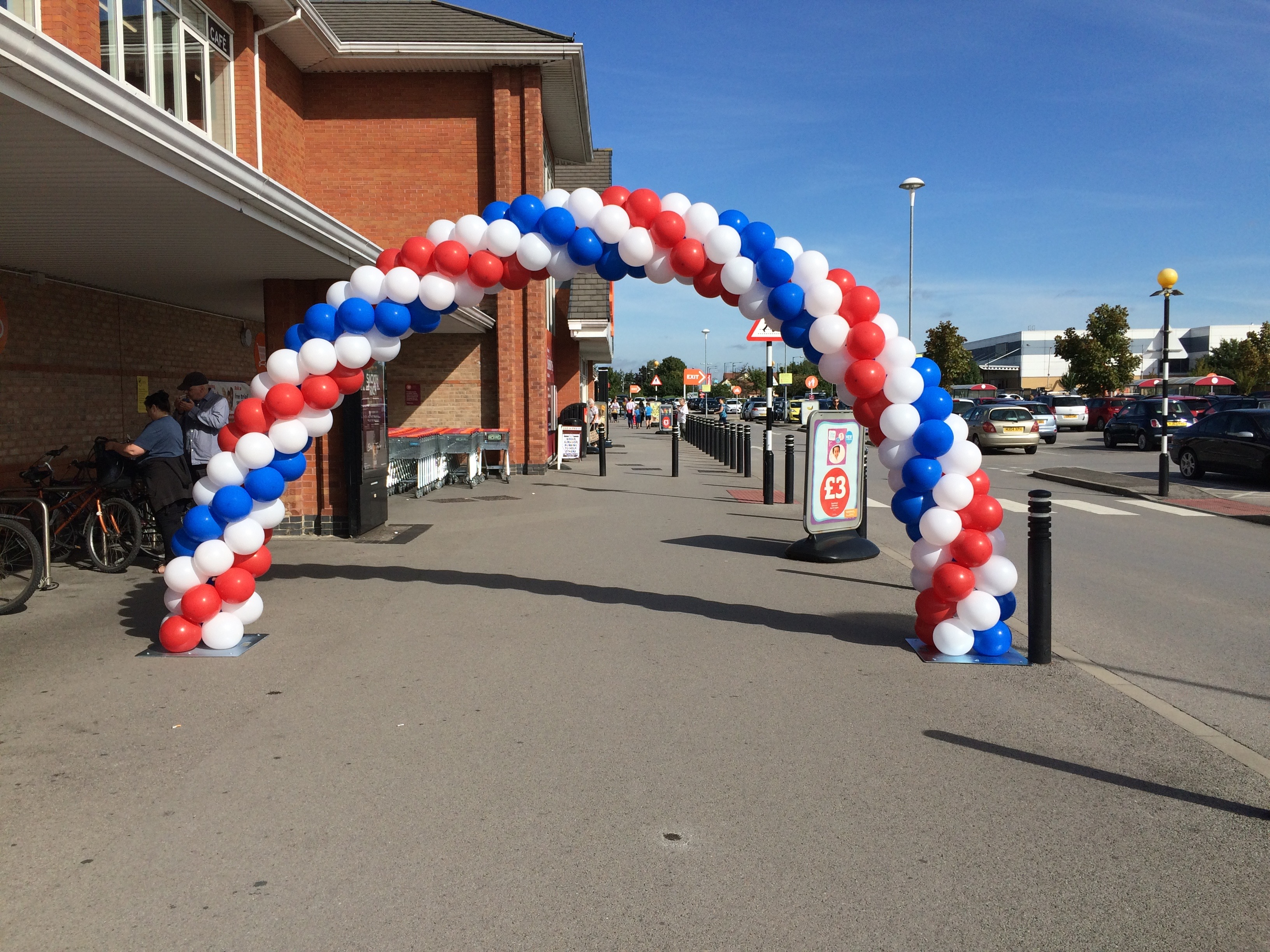 sainsbury's balloon arch aeropole red white blue