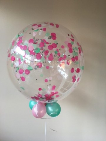 Pink and pastel green confetti bubble