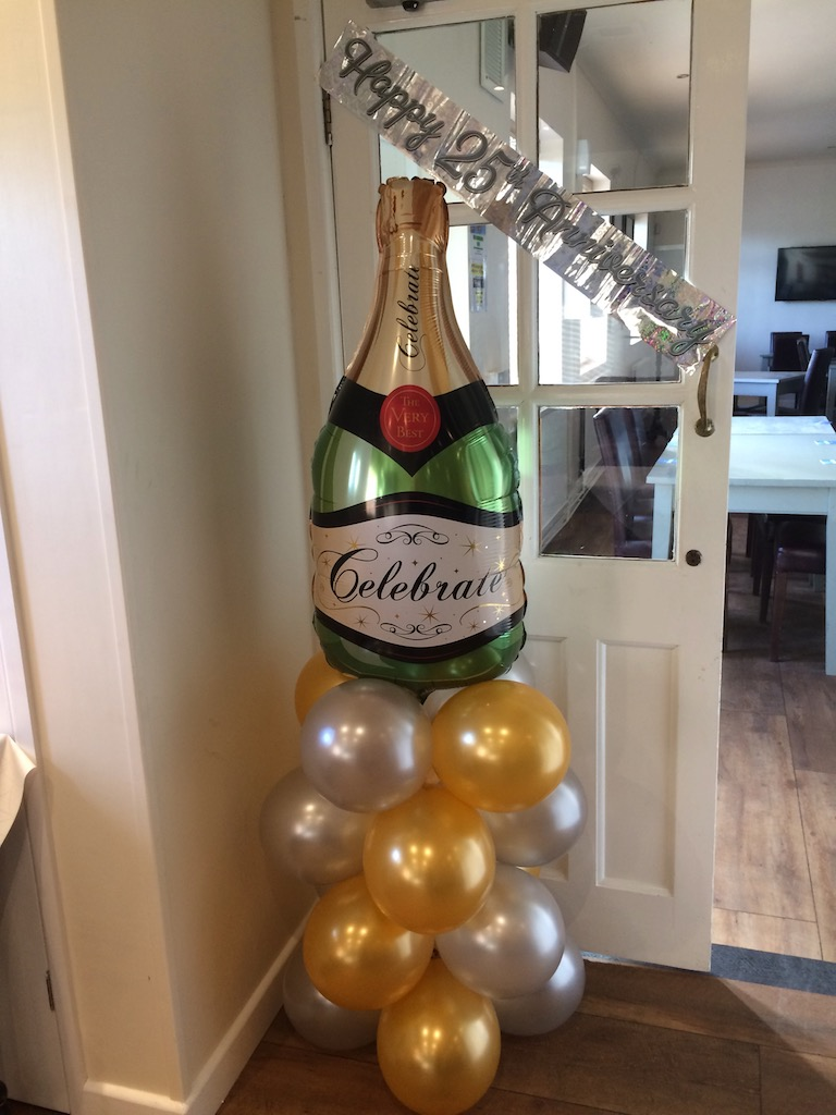 champagne bottle gold silver balloon stack
