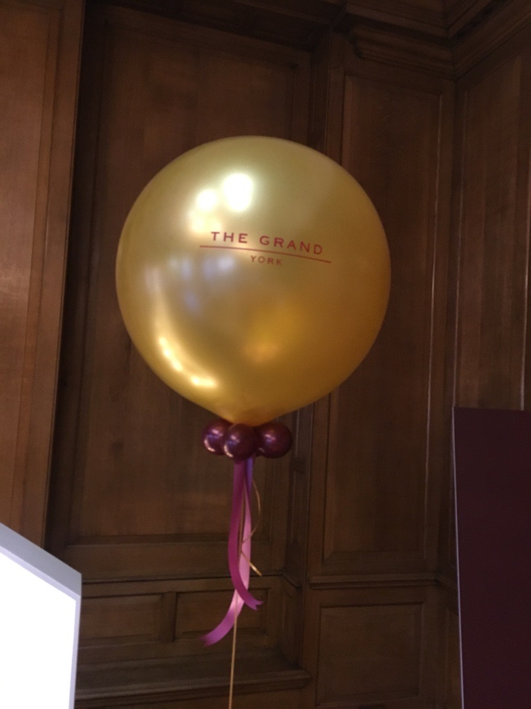 giant balloon, logo, gold,