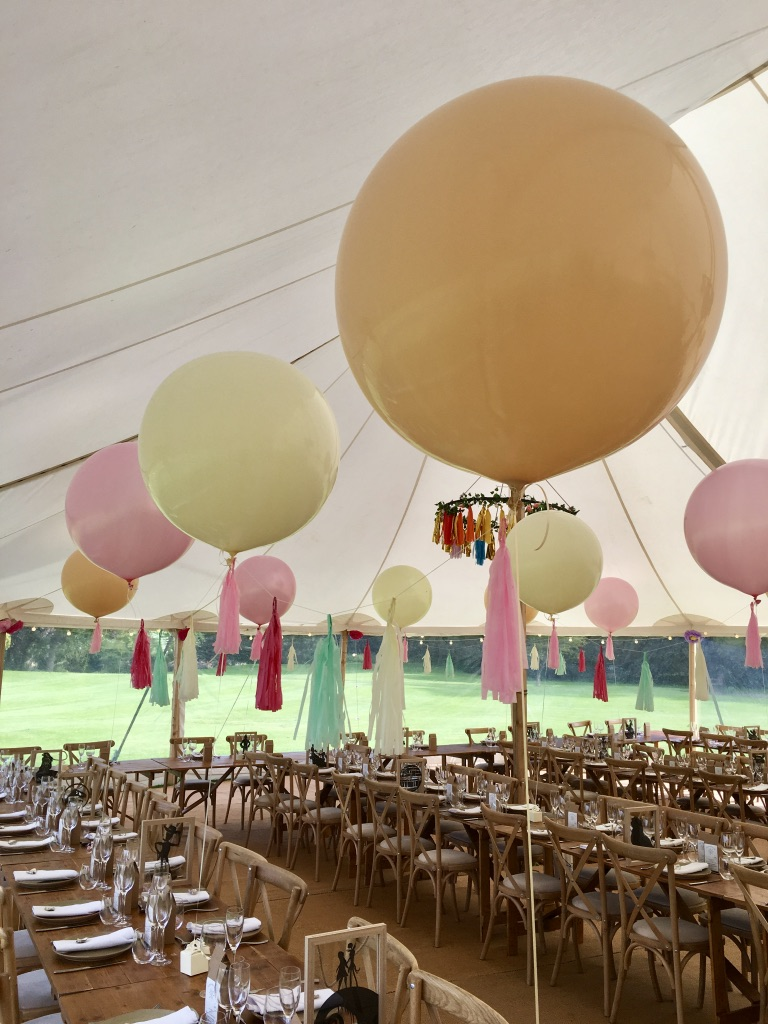 Pastel Giant balloons with tassels in marquee
