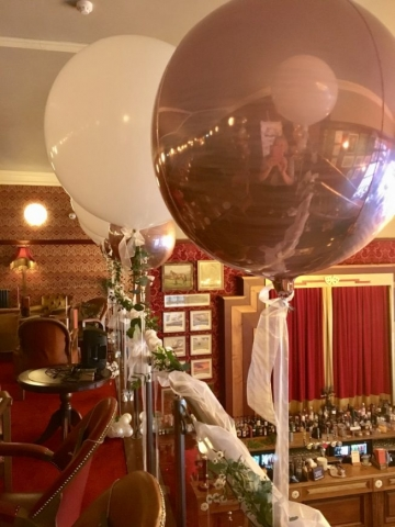 Giant balloons with eucalyptus and Orbz on Organza balcony display