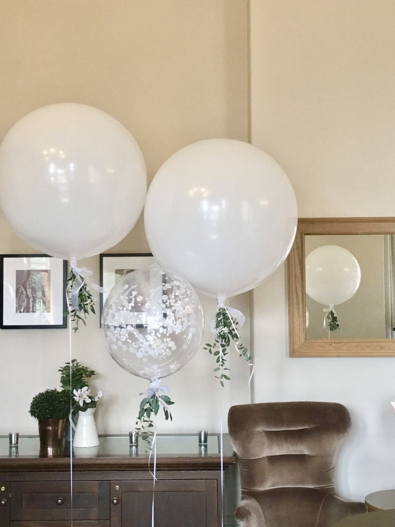 Giant balloon with eucalyptus and confetti bubble combination